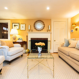 Design ideas for a large traditional formal enclosed living room in Boston with yellow walls, carpet, a standard fireplace and a wood fireplace surround.