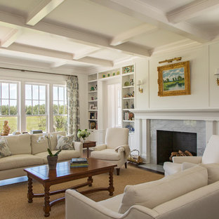 チャールストンの大きいビーチスタイルのおしゃれなリビング (フォーマル、白い壁、濃色無垢フローリング、標準型暖炉、石材の暖炉まわり、テレビなし、茶色い床) の写真