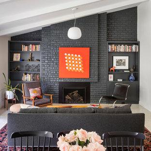 Immagine di un grande soggiorno moderno stile loft con sala formale, pareti bianche, pavimento in cemento, camino classico e cornice del camino in mattoni