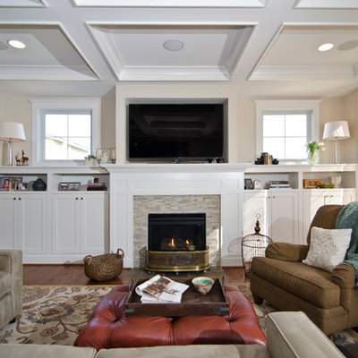 Example of a classic living room design in DC Metro with beige walls, a standard fireplace and a tile fireplace