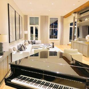 Ispirazione per un grande soggiorno aperto con sala della musica e pareti beige
