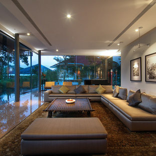 This is an example of a contemporary living room in Singapore with grey walls, medium hardwood flooring, no fireplace and no tv.
