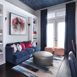 Example of a transitional enclosed dark wood floor living room design in Orange County with gray walls
