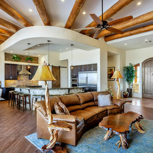 Living Room   Southwestern Open Concept Dark Wood Floor And Brown Floor Living  Room Idea In