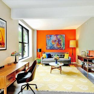 Idee per un soggiorno minimalista di medie dimensioni con sala formale e pareti arancioni