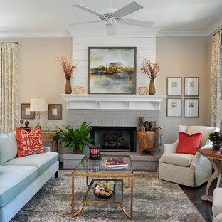 Ejemplo de salón abierto, clásico renovado, de tamaño medio, con paredes beige, suelo de madera en tonos medios, chimenea tradicional y marco de chimenea de ladrillo