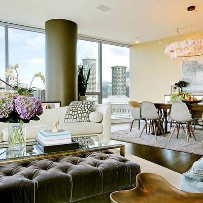 Example of a trendy open concept dark wood floor living room design in Seattle with beige walls