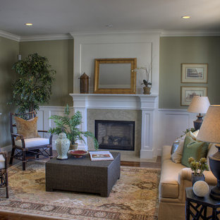 Elegant formal living room photo in San Francisco with green walls, a standard fireplace and no tv