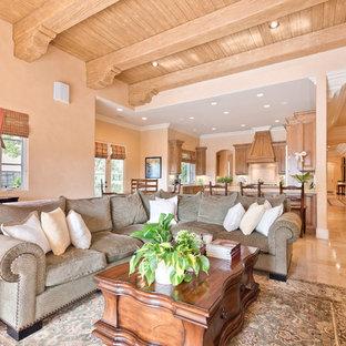 Ispirazione per un grande soggiorno tradizionale aperto con pareti rosa, pavimento in pietra calcarea, camino classico, cornice del camino in pietra e parete attrezzata