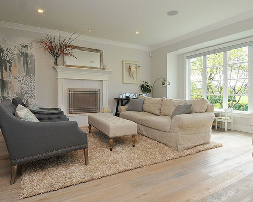 elegant light wood floor living room photo in vancouver with gray walls and a standard fireplace - Silver Living Room Walls