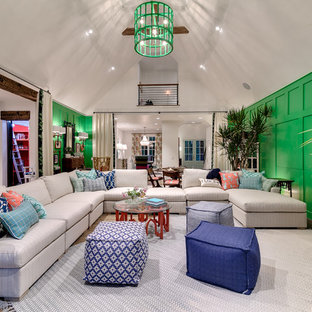 Inspiration for a beach style light wood floor living room remodel in Oklahoma City with green walls