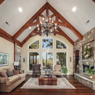 Inspiration for a traditional formal enclosed living room in Other with beige walls, medium hardwood floors, a ribbon fireplace, a stone fireplace surround and no tv.