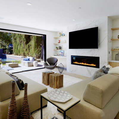 Inspiration for a contemporary light wood floor and beige floor living room remodel in Los Angeles with white walls, a ribbon fireplace, a stone fireplace and a wall-mounted tv