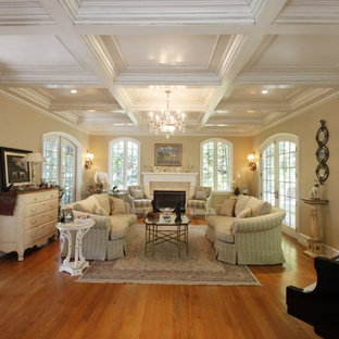 Example of a large arts and crafts enclosed and formal light wood floor living room design in New York with beige walls, a standard fireplace and a plaster fireplace