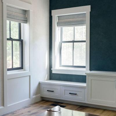 Example of a large cottage medium tone wood floor living room design in Boston