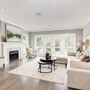 Example of a transitional formal dark wood floor and brown floor living room design in DC Metro with gray walls, a standard fireplace, a tile fireplace and no tv