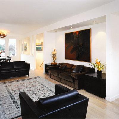Trendy open concept beige floor living room photo in San Francisco with white walls