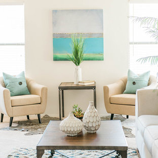 Example of a small coastal open concept carpeted living room design in Phoenix with beige walls