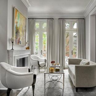 Idee per un soggiorno classico con sala formale, pareti grigie, camino classico, cornice del camino in pietra, nessuna TV, pavimento marrone e parquet scuro