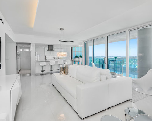 example of a trendy white floor living room design in miami with white walls and a - Interior Design Living Room Contemporary