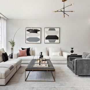 Modelo de salón para visitas abierto, retro, con paredes blancas, moqueta y suelo gris