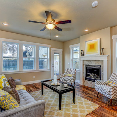 Example of a large transitional formal and enclosed medium tone wood floor and brown floor living room design in Boise with beige walls, a standard fireplace, no tv and a tile fireplace