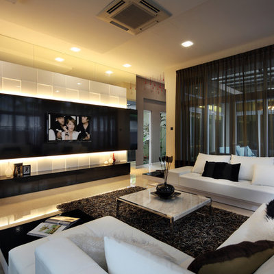 Inspiration for a contemporary living room remodel in Singapore with a media wall