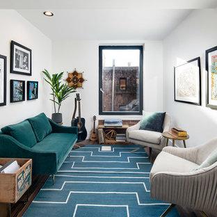 Ejemplo de salón con rincón musical clásico renovado, sin chimenea y televisor, con paredes blancas, suelo de madera oscura y suelo azul