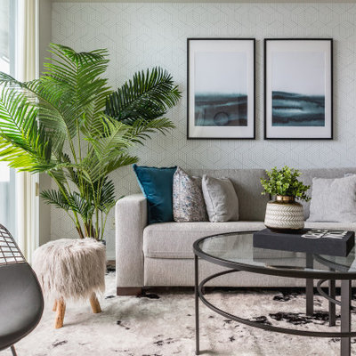 Example of a mid-sized trendy living room design in Toronto with gray walls
