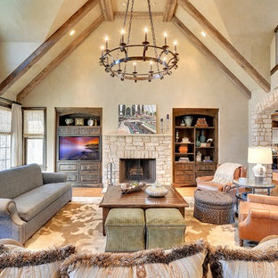 Living room - huge traditional open concept and formal medium tone wood floor living room idea in Minneapolis with beige walls, a standard fireplace, a stone fireplace and a media wall
