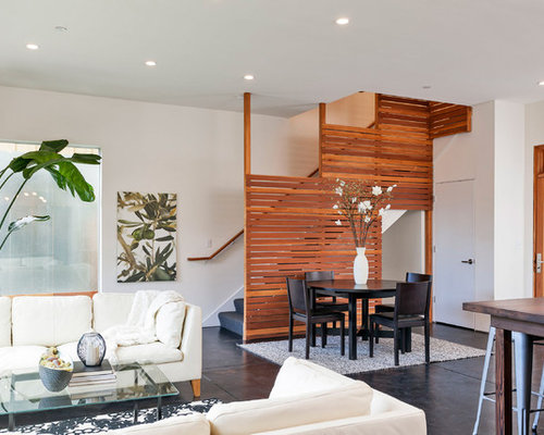 Example Of A Trendy Open Concept Living Room Design In San Francisco With Concrete Floors