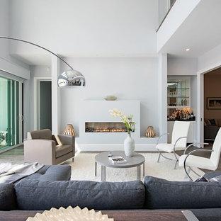 Example Of A Trendy Medium Tone Wood Floor And Gray Floor Living Room Design  In Miami