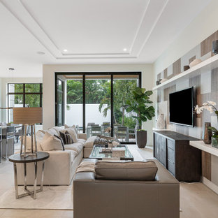 Example of a mid-sized trendy open concept ceramic floor and beige floor living room design in Miami with beige walls and a wall-mounted tv