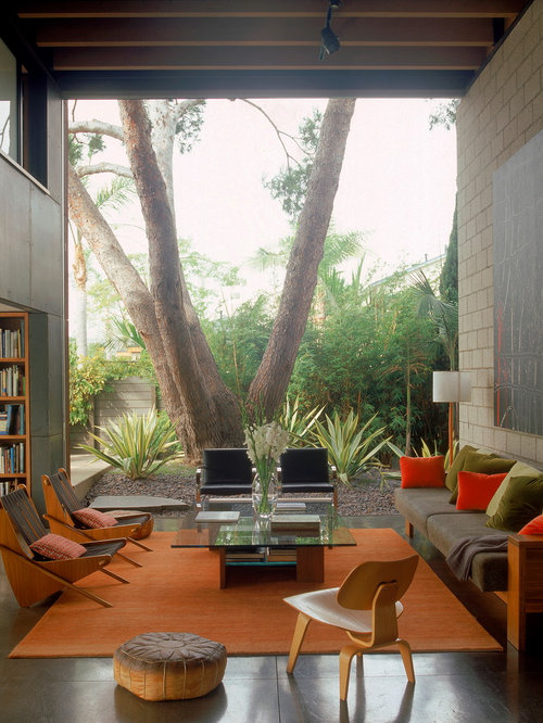 Example of a trendy concrete floor and gray floor living room design in Los  Angeles