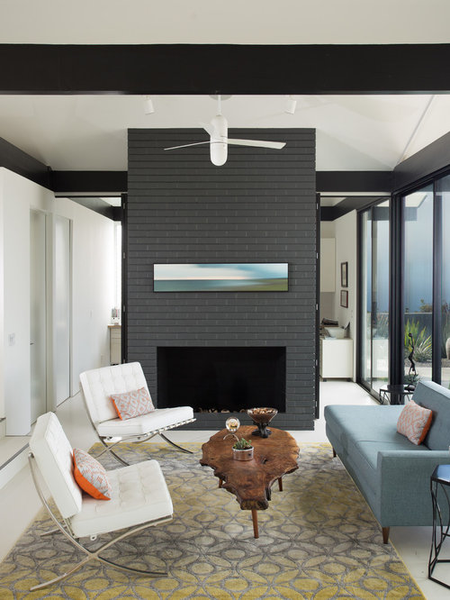 inspiration for a 1950s living room remodel in los angeles with a standard fireplace and a