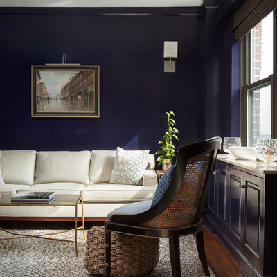 Large elegant formal and enclosed medium tone wood floor and brown floor living room photo in New York with blue walls, no fireplace and no tv
