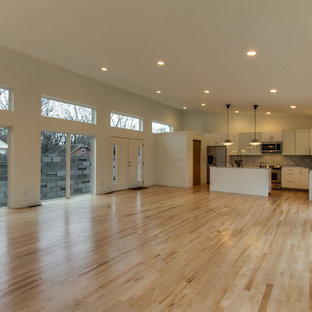 Inspiration for a mid-sized modern open concept light wood floor living room remodel in Nashville with white walls