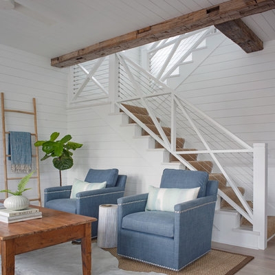 Small beach style open concept light wood floor and brown floor living room photo with white walls and no fireplace