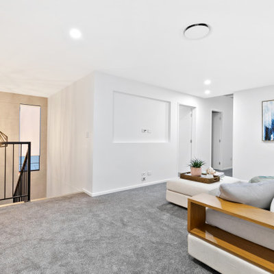 Example of a living room design in Brisbane with a media wall