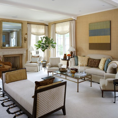 Example of a classic living room design in DC Metro with beige walls, a standard fireplace and no tv