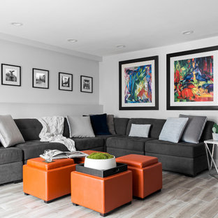 Inspiration for a transitional gray floor living room remodel in New York with gray walls
