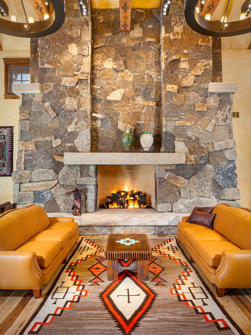 Southwest formal light wood floor living room photo in Denver with a  standard fireplace and a