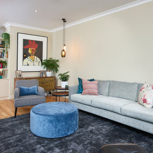 Photo of a transitional living room in Melbourne with beige walls, medium hardwood floors and brown floor.