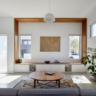This is an example of a mid-sized scandinavian open concept living room in Melbourne with concrete floors and grey floor.