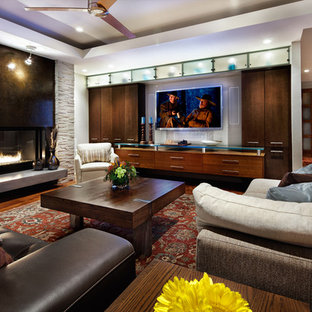 Mid-sized trendy open concept medium tone wood floor living room photo in Austin with a two-sided fireplace and a wall-mounted tv