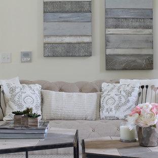 シャーロットの広い地中海スタイルのおしゃれな独立型リビング (フォーマル、ベージュの壁、無垢フローリング、暖炉なし、テレビなし、茶色い床) の写真