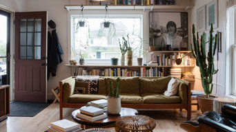 A living area surrounded by books and music.