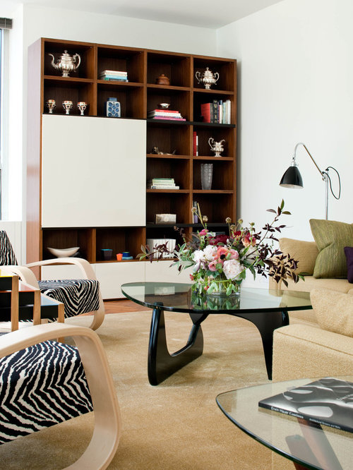 midcentury modern living room idea in new york with white walls