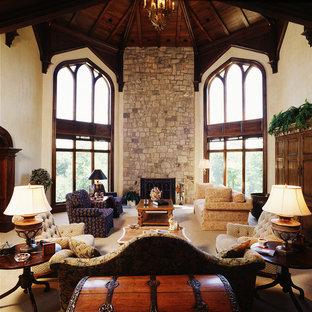 Idee per un ampio soggiorno mediterraneo aperto con sala formale, pareti beige, moquette, camino classico, nessuna TV e cornice del camino in pietra