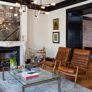 Living room - mid-sized eclectic formal and enclosed medium tone wood floor living room idea in DC Metro with a standard fireplace, no tv and white walls